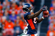 Wide receiver Demaryius Thomas #88 of the Denver Broncos jumps for a pass while being defended by cornerback Morris Claiborne #21 of the New York Jets during the second quarter at Sports Authority Field at Mile High on December 10, 2017 in Denver, Colorado.
