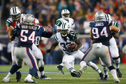 Chris Ivory #33 of the New York Jets carries the ball during the second quarter against the New England Patriots at Gillette Stadium on October 16, 2014 in Foxboro, Massachusetts.