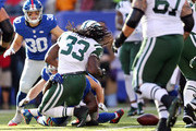 Chris Ivory #33 of the New York Jets fumbles the ball in the second quarter against the New York Giants at MetLife Stadium on December 6, 2015 in East Rutherford, New Jersey.