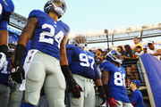 Terrell Thomas, Linval Joseph, and  Hakeem Nicks #88 of the New York Giants wait to take the field against the New York Jets during their pre season game at MetLife Stadium on August 24, 2013 in East Rutherford, New Jersey.
