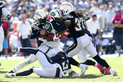 Running back Chris Ivory #33 of the New York Jets is stopped by safeties Eric Weddle #32 Jahleel Addae #37 if the San Diego Chargers at Qualcomm Stadium on October 5, 2014 in San Diego, California.