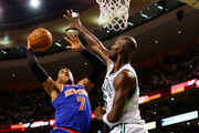 Carmelo Anthony #7 of the New York Knicks drives to the basket in front of Kevin Garnett #5 of the Boston Celtics during Game Four of the Eastern Conference Quarterfinals of the 2013 NBA Playoffs on April 28, 2013 at TD Garden in Boston, Massachusetts. NOTE TO USER: User expressly acknowledges and agrees that, by downloading and or using this photograph, User is consenting to the terms and conditions of the Getty Images License Agreement.