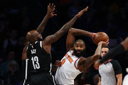 Kyle O'Quinn #9 of the New York Knicks looks to pass against Quincy Acy #13 of the Brooklyn Nets during their game at the Barclays Center on January 15, 2018 in New York City.  . User expressly acknowledges and agrees that, by downloading and/or using this Photograph, user is consenting to the terms and conditions of the Getty Images License Agreement.