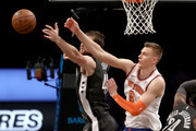 Tyler Zeller #44 of the Brooklyn Nets and Kristaps Porzingis #6 of the New York Knicks fight for the ball in the third quarter at the Barclays Center on December 14, 2017 in the Brooklyn borough of New York City.  NOTE TO USER: User expressly acknowledges and agrees that, by downloading and or using this Photograph, user is consenting to the terms and conditions of the Getty Images License Agreement.