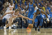 Ron Baker #31 of the New York Knicks and Raymond Felton #2 of the Oklahoma City Thunder battle for a ball during the first half of a NBA  game at the Chesapeake Energy Arena on October 19, 2017 in Oklahoma City, Oklahoma. NOTE TO USER: User expressly acknowledges and agrees that, by downloading and or using this photograph, User is consenting to the terms and conditions of the Getty Images License Agreement.