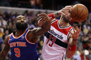Kyle O'Quinn #9 of the New York Knicks battles Marcin Gortat #13 of the Washington Wizards for a rebound during the first half at Capital One Arena on January 3, 2018 in Washington, DC. NOTE TO USER: User expressly acknowledges and agrees that, by downloading and or using this photograph, User is consenting to the terms and conditions of the Getty Images License Agreement.