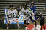 Kevin Drew #19 of the Charlotte Hounds tries to stop Greg Gurenlian #32 of the New York Lizards during their game at American Legion Memorial Stadium on May 30, 2015 in Charlotte, North Carolina.