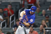 Right fielder Jay Bruce #19 of the New York Mets hits an RBI double in the sixth inning during the game against the Atlanta Braves at SunTrust Park on June 12, 2018 in Atlanta, Georgia.