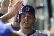 Anthony Rizzo #44 of the Chicago Cubs is greeted in the dugout after scoring a run and getting his 1,000th Cubs career hit, a double in the 7th inning against the New York Mets, at Wrigley Field on August 27, 2018 in Chicago, Illinois.