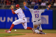 Andres Blanco #4 of the Philadelphia Phillies looks back as the ball drops and Asdrubal Cabrera #13 of the New York Mets slides safe into second base in the sixth inning at Citizens Bank Park on April 19, 2016 in Philadelphia, Pennsylvania. The Mets won 11-1.