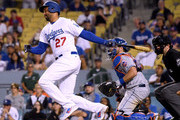 Matt Kemp #27 of the Los Angeles Dodgers grounds into a game ending double play in front of Devin Mesoraco #29 of the New York Mets during a 4-2 Mets win at Dodger Stadium on September 3, 2018 in Los Angeles, California.