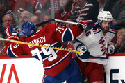 Andrei Markov #79 of the Montreal Canadiens checks Martin St. Louis #26 of the New York Rangers during Game Two of the Eastern Conference Final during the 2014 Stanley Cup Playoffs at Bell Centre on May 19, 2014 in Montreal, Canada.