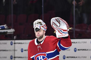 Goaltender Antti Niemi #37 of the Montreal Canadiens raises his arm to acknowledge the fans after his victory against the New York Rangers during the NHL game at the Bell Centre on February 22, 2018 in Montreal, Quebec, Canada.  The Montreal Canadiens defeated the New York Rangers 3-1.