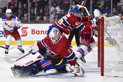 Goaltender Antti Niemi #37 of the Montreal Canadiens reaches behind him to cover the puck as teammate Joe Morrow #45 defends against Jimmy Vesey #26 of the New York Rangers during the NHL game at the Bell Centre on February 22, 2018 in Montreal, Quebec, Canada.