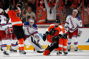 (L-R) Scott Hartnell #19, Wayne Simmonds #17 and Claude Giroux #28 of the Philadelphia Flyers celebrate Simmond's powerplay goal at 7:08 of the first period against the New York Rangers in Game Six of the First Round of the 2014 NHL Stanley Cup Playoffs at the Wells Fargo Center on April 29, 2014 in Philadelphia, Pennsylvania.