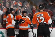 Claude Giroux #28 of the Philadelphia Flyers (c) celebrates his goal at 17:59 of the second period against the New York Rangers and is joined by Sean Couturier #14 (l) and Michael Raffl #12 (r) at the Wells Fargo Center on April 7, 2018 in Philadelphia, Pennsylvania.
