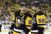 Sidney Crosby #87 of the Pittsburgh Penguins and Kris Letang #58 talk before a face-off in Game Five of the Eastern Conference First Round against the New York Rangers during the 2016 NHL Stanley Cup Playoffs at Consol Energy Center on April 23, 2016 in Pittsburgh, Pennsylvania.