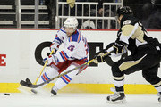 Martin St. Louis #26 of the New York Rangers handles the puck against David Perron #39 of the Pittsburgh Penguins in Game Three of the Eastern Conference Quarterfinals during the 2015 NHL Stanley Cup Playoffs at Consol Energy Center on April 20, 2015 in Pittsburgh, Pennsylvania.