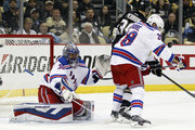 Goalie Henrik Lundqvist #30 of the New York Rangers is screened by teammate Dominic Moore #28 and David Perron #39 of the Pittsburgh Penguins in Game Four of the Eastern Conference Quarterfinals during the 2015 NHL Stanley Cup Playoffs at Consol Energy Center on April 22, 2015 in Pittsburgh, Pennsylvania.