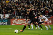 Chris Pontius #13 of D.C. United takes a penalty kick against the New York Red Bulls in the first half during their Eastern Conference Semifinal match at RFK Stadium on November 3, 2012 in Washington, DC.