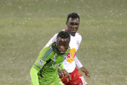 Steve Zakuani #11 of the Seattle Sounders brings the ball up field while being defended by Lloyd Sam #10 of the New York Red Bulls at Kino Sports Complex on February 20, 2013 in Tucson, Arizona.
