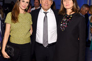 (L-R)  Livia Firth, Wolfgang Schattling, and Karla Otto attends the The New York Times International Luxury Conference at Mandarin Oriental on December 1, 2014 in Miami, Florida.