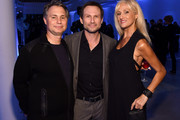 (L-R) Jason Binn, Christian Slater and a guest  attend the Speaker Dinner presented by Mercedes-Benz during The New York Times International Luxury Conference at the Moore Building on December 1, 2014 in Miami, Florida.
