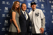 Centerfielder Jacoby Ellsbury, right, stands with his agent Scott Boras and his wife Kelsey Ellsbury during his introductory press conference at Yankee Stadium on December 13, 2013 in the Bronx borough of New York City.