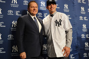 Centerfielder Jacoby Ellsbury stands with his agent Scott Boras during his introductory press conference at Yankee Stadium on December 13, 2013 in the Bronx borough of New York City.