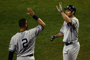 Johnny Damon #18 (R) and Derek Jeter #2 of the New York Yankees celebrate after Damon scored on a RBI double by ALex Rodriguez #13 in the top of the ninth inning against the Philadelphia Phillies in Game Four of the 2009 MLB World Series at Citizens Bank Park on November 1, 2009 in Philadelphia, Pennsylvania.