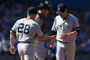 Jaime Garcia #34 (R) of the New York Yankees is pulled from the game during MLB game action against the Toronto Blue Jays at Rogers Centre on September 24, 2017 in Toronto, Canada.