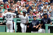 Gleyber Torres #25 of the New York Yankees high-fives Andrew McCutchen #26 of the New York Yankees after hitting a home run at the top of the fourth inning of the game against the Boston Red Sox at Fenway Park on September 29, 2018 in Boston, Massachusetts.