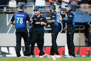 (L-R) Corey Anderson,Brendon McCullum, Grant Elliot and Martin Guptill of New Zealand celebrate following the One Day International match between New Zealand and Australia at Eden Park on February 3, 2016 in Auckland, New Zealand.