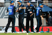 (L-R) Corey Anderson, Grant Elliott, Martin Guptill and Brendon McCullum of New Zealand celebrate following the One Day International match between New Zealand and Australia at Eden Park on February 3, 2016 in Auckland, New Zealand.
