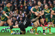 Cooper Cronk of Australia is tackled by Sonny Bill Williams of New Zealand during the Rugby League World Cup Final between New Zealand and Australia at Old Trafford on November 30, 2013 in Manchester, England.