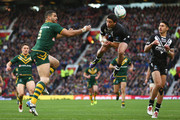 Greg Inglis (L) of Australia challenges Kevin Locke (R) of New Zealand for a high ball during the Rugby League World Cup Final between Australia and New Zealand at Old Trafford on November 30, 2013 in Manchester, England.