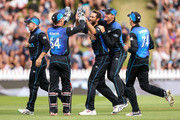 Grant Elliott of New Zealand celebrates with Luke Ronchi and Martin Guptill after taking the wicket of Sohaib Maqsood of Pakistan during the One Day International match between New Zealand and Pakistan at Basin Reserve on January 25, 2016 in Wellington, New Zealand.