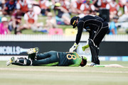 Shoaib Malik of Pakistan gets hit on the head by a ball as Tom Latham of New Zealand rushes to him during game four of the One Day International Series between New Zealand and Pakistan at Seddon Park on January 16, 2018 in Hamilton, New Zealand.