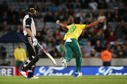 Imran Tahir of South Africa celebrates with teammates for the wicket of Ben Wheeler of New Zealand during the first International Twenty20 match between New Zealand and South Africa at Eden Park on February 17, 2017 in Auckland, New Zealand.