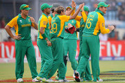 Imran Tahir (C) of South Africa celebrates with team mates after claiming the wicket of Ross Taylor of New Zealand during the 2011 ICC World Cup Quarter-Final match between New Zealand and South Africa at Shere-e-Bangla National Stadium on March 25, 2011 in Dhaka, Bangladesh.