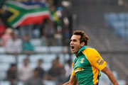 Imran Tahir of South Africa celebrates the wicket of Ross Taylor of New Zealand who was caught during 2011 ICC World Cup Quarter-Final match between New Zealand and South Africa at Shere-e-Bangla National Stadium on March 25, 2011 in Dhaka, Bangladesh.
