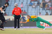 Imran Tahir (R) of South Africa fields during the 2011 ICC World Cup Quarter-Final match between New Zealand and South Africa at Shere-e-Bangla National Stadium on March 25, 2011 in Dhaka, Bangladesh.
