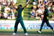 Imran Tahir of South Africa celebrates his wicket of Kane Williamson of New Zealand during game four of the One Day International series between New Zealand and South Africa at  on March 1, 2017 in Hamilton, New Zealand.