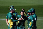Imran Tahir of South Africa celebrates with teammates for the wicket of Tim Southee of New Zealand during game five of the One Day International series between New Zealand and South Africa at Eden Park on March 4, 2017 in Auckland, New Zealand.