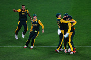 Francois du Plessis of South Africa, Imran Tahir of South Africa, Hashim Amla of South Africa, AB de Villiers of South Africa and Quinton de Kock of South Africa celebrate the wicket of Martin Guptill of New Zealand during the 2015 Cricket World Cup Semi Final match between New Zealand and South Africa at Eden Park on March 24, 2015 in Auckland, New Zealand.