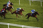Paul Hanagan riding Yaseen (R) to win The Coln Valley Stud Bridget Maiden Fillies' Stakes at Newbury racecourse on April 17, 2015 in Newbury, England.
