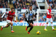 Hatem Ben Arfa of Newcastle United is closed down by Jack Wilshere of Arsenal during the Barclays Premier League match between Newcastle United and Arsenal at St James' Park on December 29, 2013 in Newcastle upon Tyne, England.