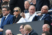 Mike Ashley, owner of Newcastle United and Lee Charnley, managing director of Newcastle United both look on from the stands during the Sky Bet Championship match between Newcastle United and Barnsley at St James' Park on May 7, 2017 in Newcastle upon Tyne, England.