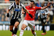 Hatem Ben Arfa of Newcastle is challenged by Don Cowie of Cardiff during the Budweiser FA Cup third round match between Newcastle United and Cardiff City at St James' Park on January 4, 2014 in Newcastle upon Tyne, England.