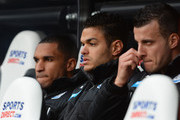 Hatem Ben Arfa (C) of Newcastle United looks on from the bench during the Barclays Premier League match between Newcastle United and Crystal Palace at St James' Park on March 22, 2014 in Newcastle upon Tyne, England.
